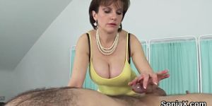 Unfaithful english mature gill ellis shows off her huge melons